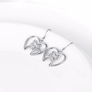 These beautiful cat earrings feature a cat inside a heart and are made of sterling silver.
