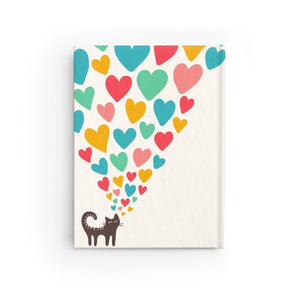 Cute and unique cat notebook featuring 128 single line pages and decorated with a black cat and hearts printed on a glossy white hard cover