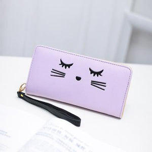 One of our favorite gifts for a cat lover, this cute cat wallet features an embroidered black cat face.