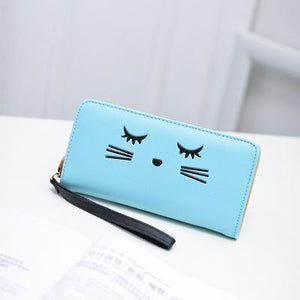 Made from PU leather and decorated with an embroidered cat face, this wristlet wallet is a cat lady favorite!