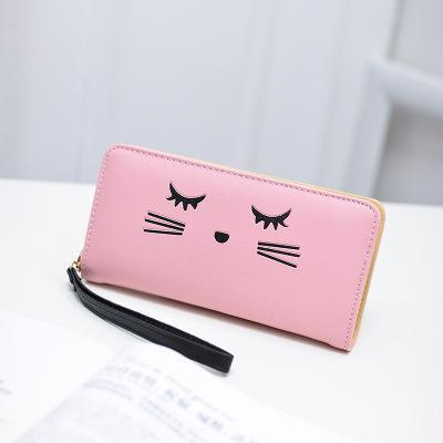 This wristlet wallet is decorated with an embroidered kitty cat face.