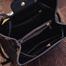 Load image into Gallery viewer, This black cat bag has many compartments and is large enough to fit all your essentials.