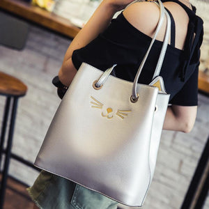Silver cat tote bag featuring golden kitty cat whiskers, nose, and 3D ears.
