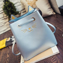 Load image into Gallery viewer, Light blue faux leather cat tote bag featuring an embroidered cat face and 3D cat ears.