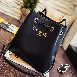 Black cat tote decorated with golden whiskers, nose, and 3D kitty cat ears.
