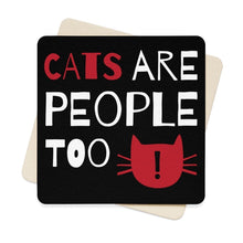 "Load image into Gallery viewer, Funny paper cat coasters featuring the print ""Cats Are People Too"" on a black background."
