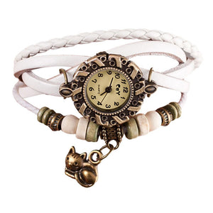 Cute cat watch with white leather straps, a vintage dial, beads, and a cat charm