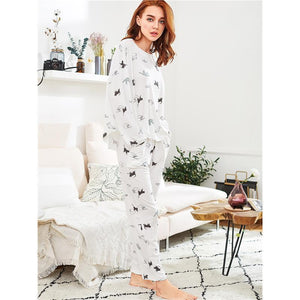 Soft and comfy womens cat pjs decorated with black and gray cats printed on a soft and stretchy fabric.
