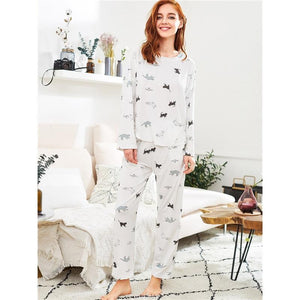 Womens cat pajamas featuring gray and black cat print on a white soft fabric.