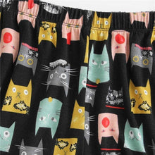 Load image into Gallery viewer, Cat pajama shorts decorated with colorful cats printed on a black fabric