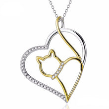 Load image into Gallery viewer, Cat Gold Jewelry, Cat Pendant Featuring a Golden Cat Inside a Silver Heart Encrusted with White Crystals