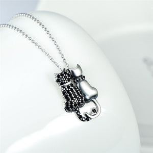 Black Cat Necklace, Cat Necklace Made of Sterling Silver and Featuring a Black Cat and a Silver Cat Snuggled Up Together