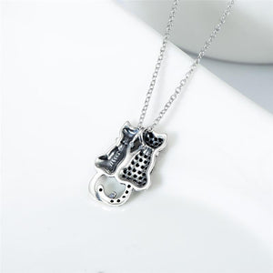 Sterling Silver Cat Necklace Featuring a Silver Cat and a Black Cat Pendant