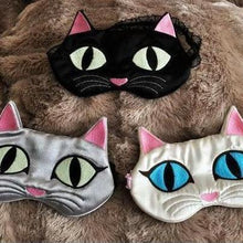 Load image into Gallery viewer, Cat sleep mask featuring handmade embroidered cat face and glow in the dark eyes