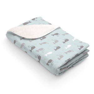 Stay cozy all year round snuggled in this unique cat blanket featuring cats in light gray, white, and blue.