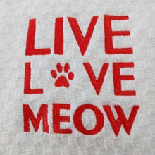 Load image into Gallery viewer, Cat kitchen towel decorated with the text Live Love Meow hand embroidered in red