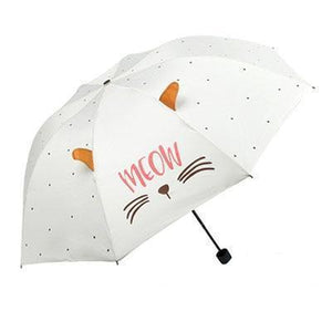 "Umbrella with cats on it decorated with 3D cat ears, black whiskers, and the print ""Meow""."