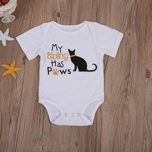 "Kids cat onesie featuring the ext ""My Sibling Has Paws"" printed across the front"