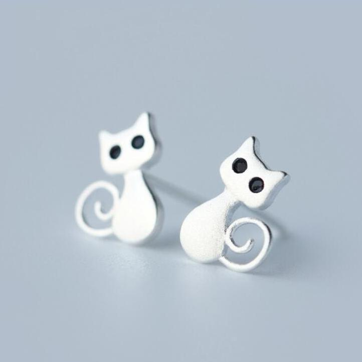 Cute cat earrings featuring silver-toned cats with happy tails and pointy ears.