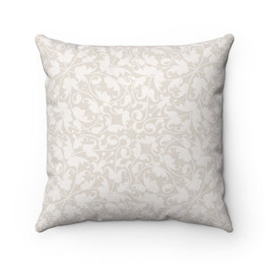 The background of this cat pillow features an abstract light beige pattern.