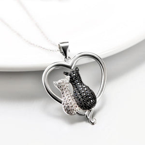 If you're looking for black cat jewelry and gift for a cat lover, pick up this White Cat Black Cat necklace featuring two crystal encrusted cats snuggling in a sterling silver heart-shaped pendant.