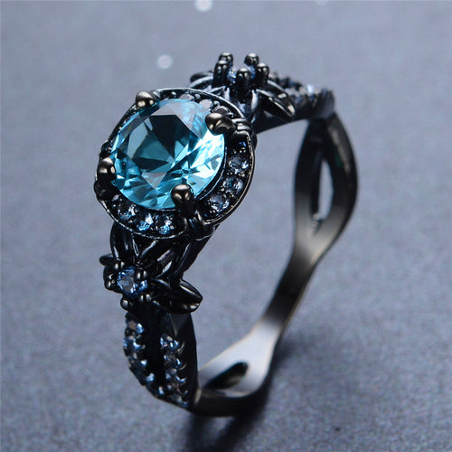 Rempli d'or noir, bague Darkness, Piercing Blue - Splendor Chic