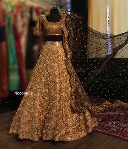 Gold Lehenga with black curved dupatta