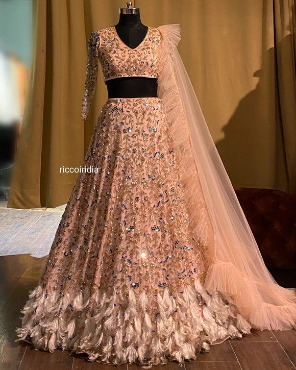 Peach lehenga with feather bottom