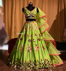 Neon green lehenga with mirrors and colorful sequins work