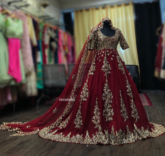 Red train lehenga with dori work and cut work dupatta
