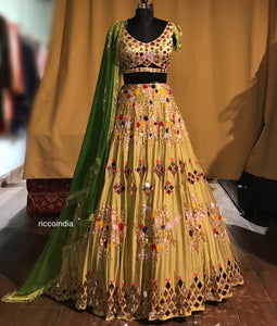 Green mirrorwork and colorful sequins lehenga with tassel dupatta