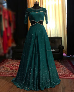 Side cut teal gown with mirrorwork and stones.