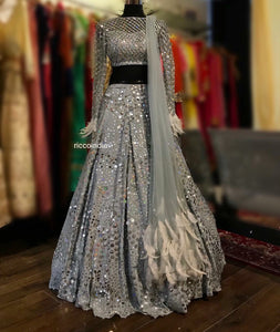 Silver Lehenga with intricate sequin work and feather detailing