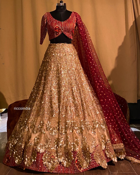 Gold sequin work layered lehenga with maroon top and dupatta