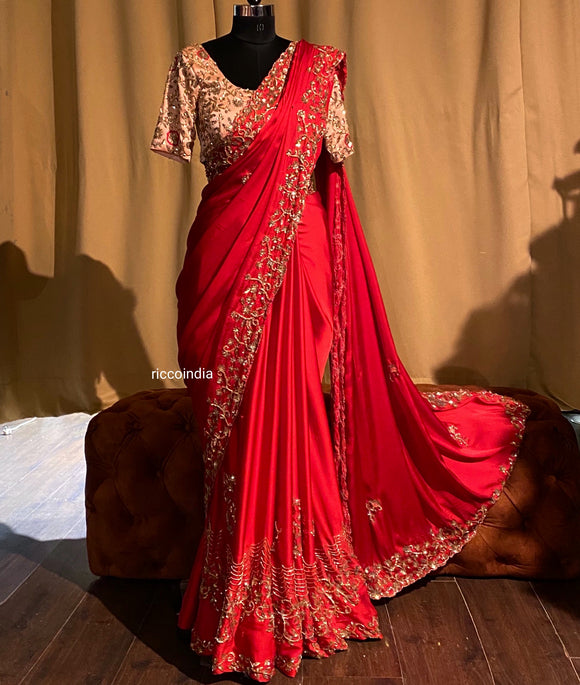 Red crepe saree with peach blouse