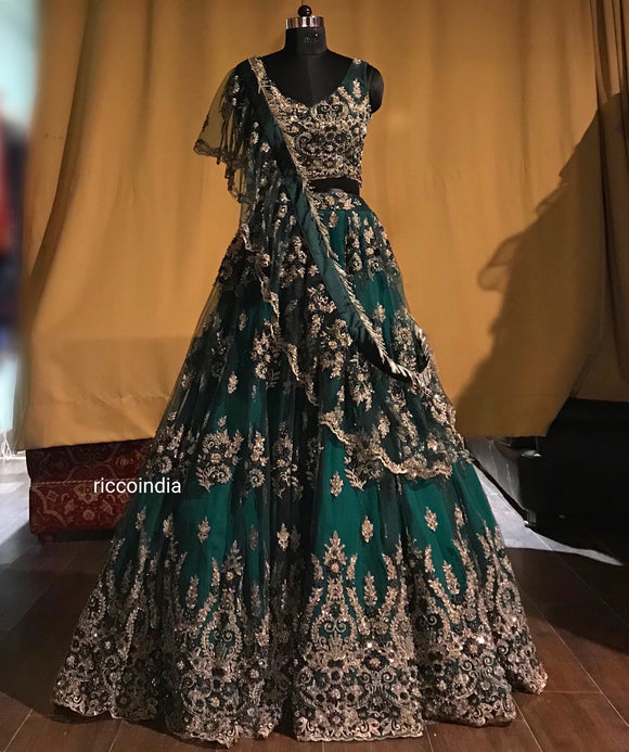 Emerald green lehenga with draped dupatta