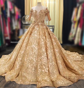 Gold couture cocktail gown with fringe sleeves