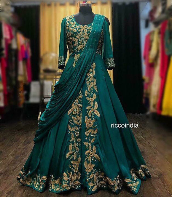Green draped sareegown with dori work