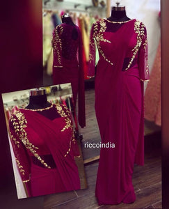 Wine draped sareegown with intricate pearl and dabka work