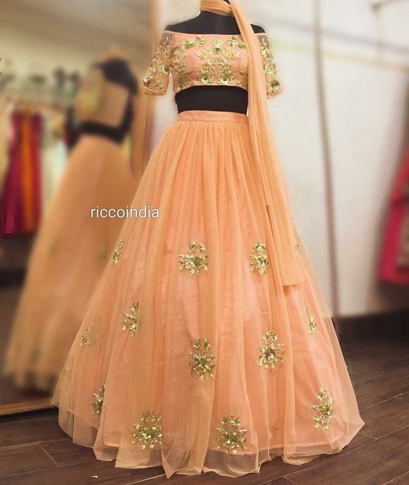 Peach off shoulder Lehenga with sequin work