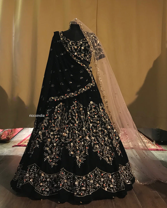 Velvet green bridal lehenga with shawl and peach net dupatta
