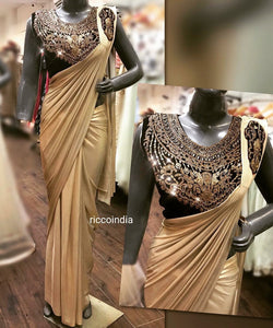 Gold stitiched saree with dark wine blouse with Swarovski embroidery