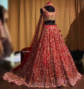 Red train lehenga with beadwork