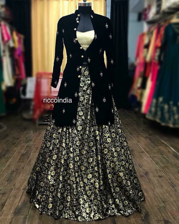 Black embroidered jacket with gold bustier and printed gold black skirt