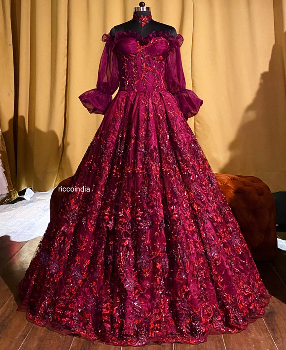 Corset gown with intricate beadwork in wine