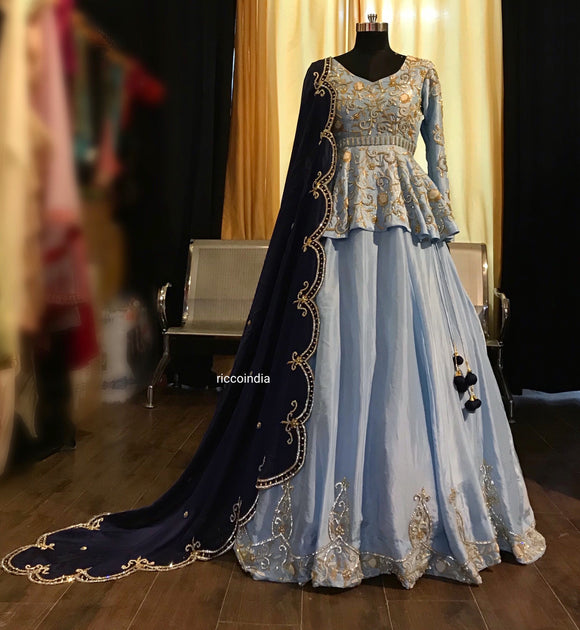 Pastel blue peplum lehenga with curved dupatt