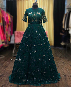 Emerald green heavily embroidered cocktail gown