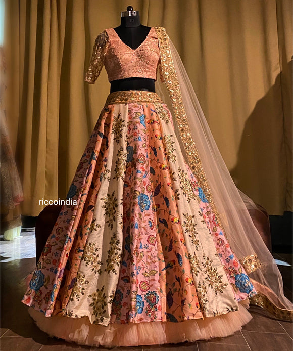 Multi color embroidered lehenga in peach with sequins work