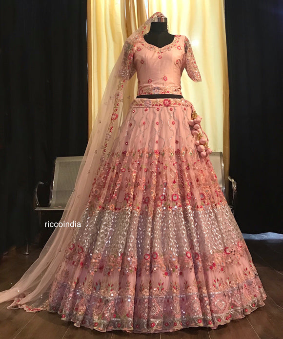 Pink heavy flare bridal lehenga with gota and Resham embroidery