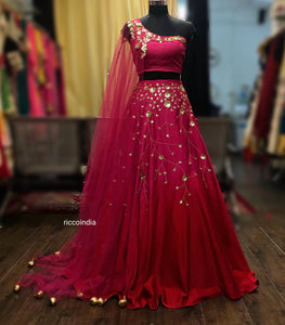 Pink one shoulder cape lehenga